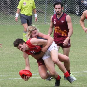Charles Gabbe applies strong tackle for the Lions