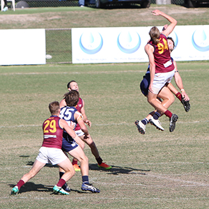 First gamer Lewis McNally flies high in the ruck